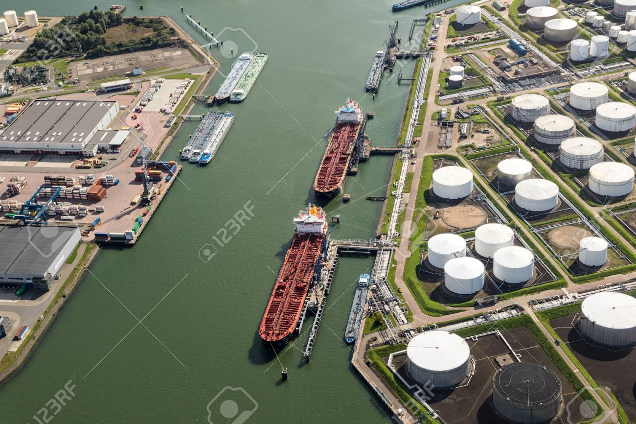 Aerial view of oil tankers moored at a oil storage terminal. - 85228875