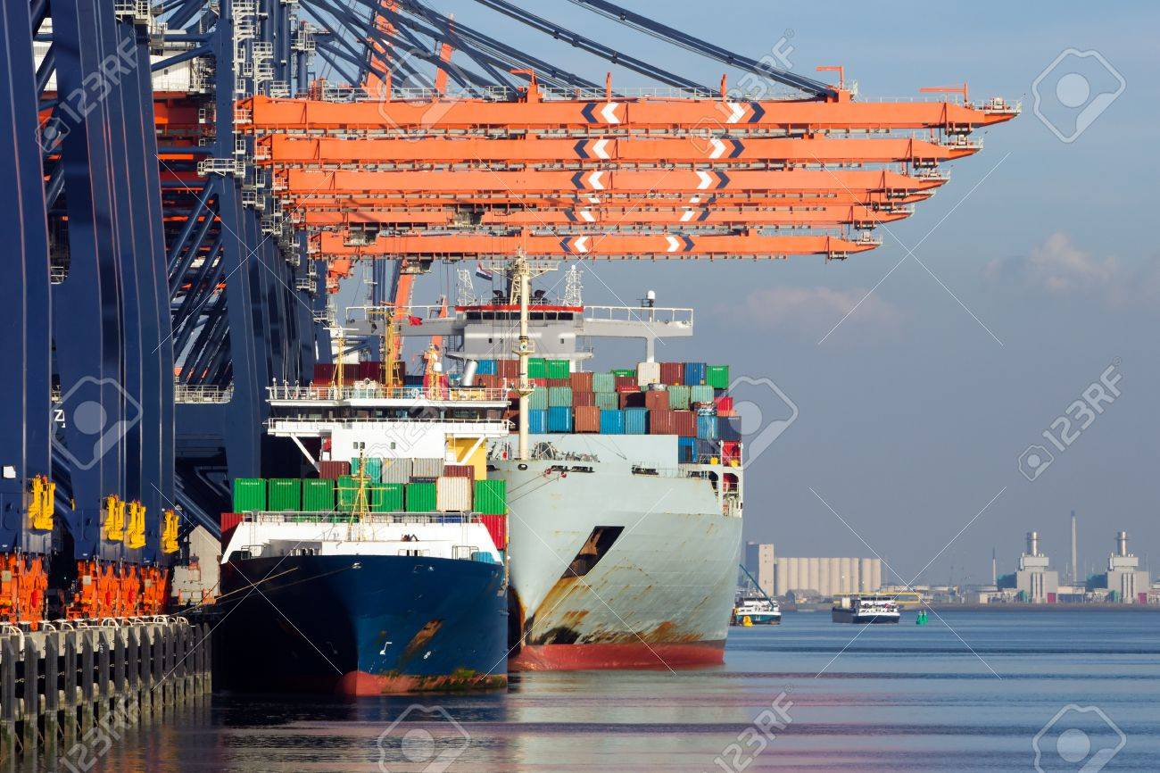 Container ships docked in the Port of Rotterdam, The Netherlands. - 87246626