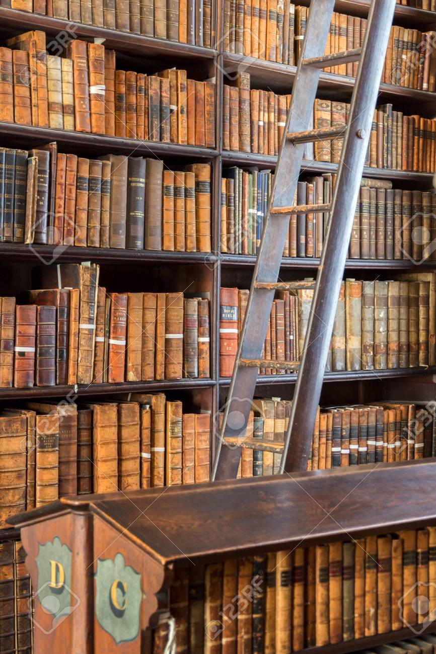 DUBLIN, IRELAND - FEB 15, 2014: Old books on shelves in the Long Room library in the Trinity College. - 90288508