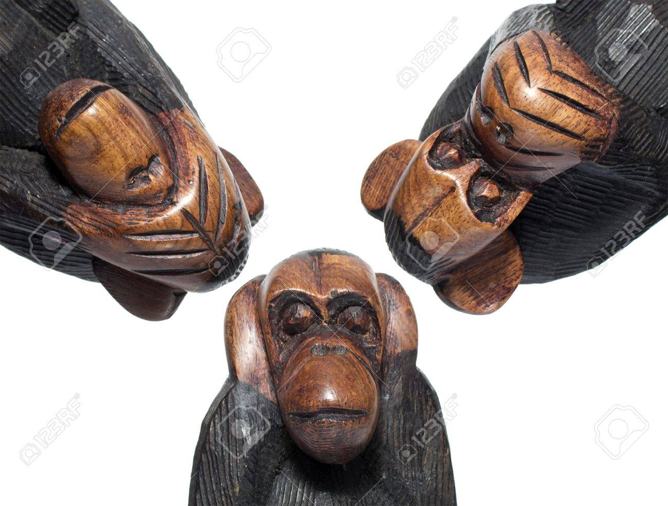 Three wooden monkeys, deaf, blind and dumb, on white background Stock Photo - 16409396