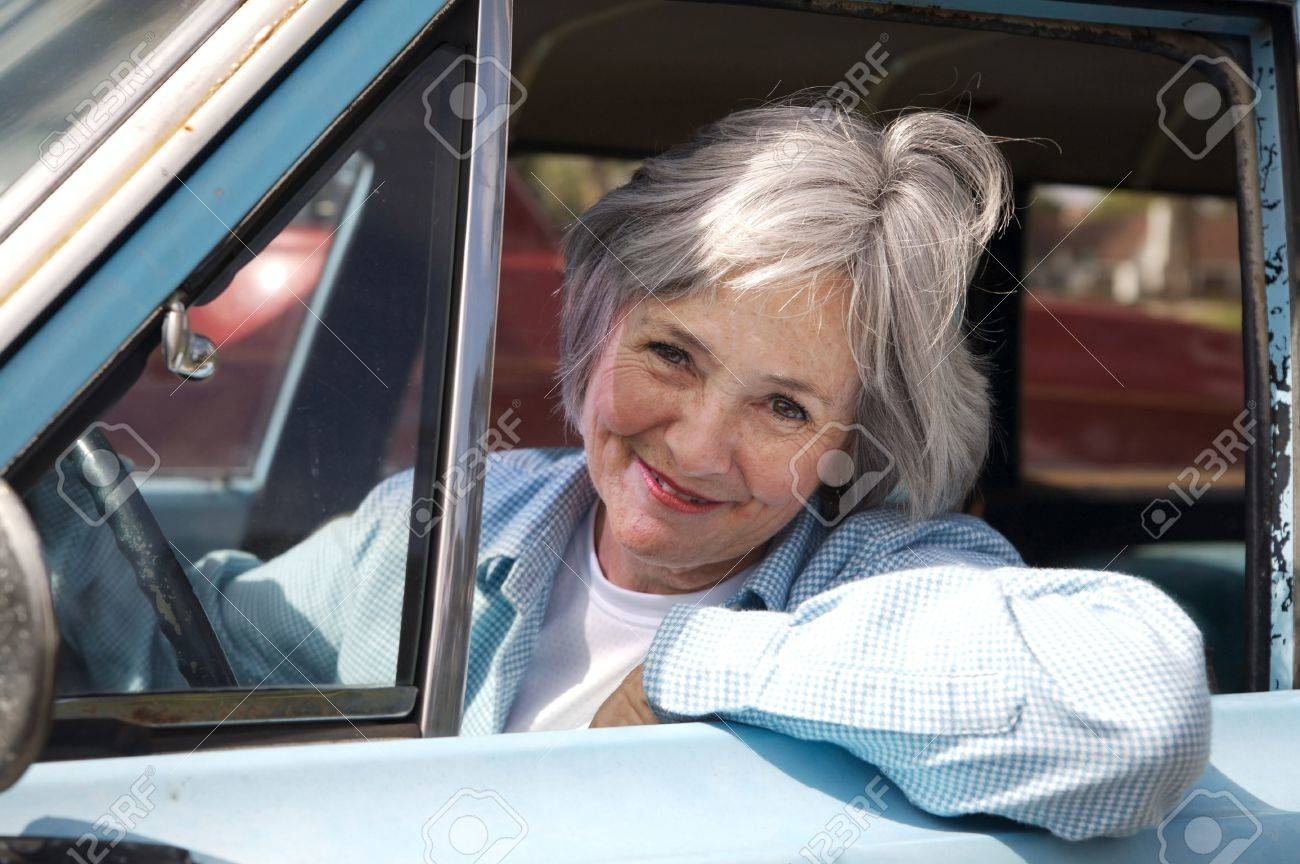 Smiling senior taking a cruise in the old rustbucket Stock Photo - 7995091