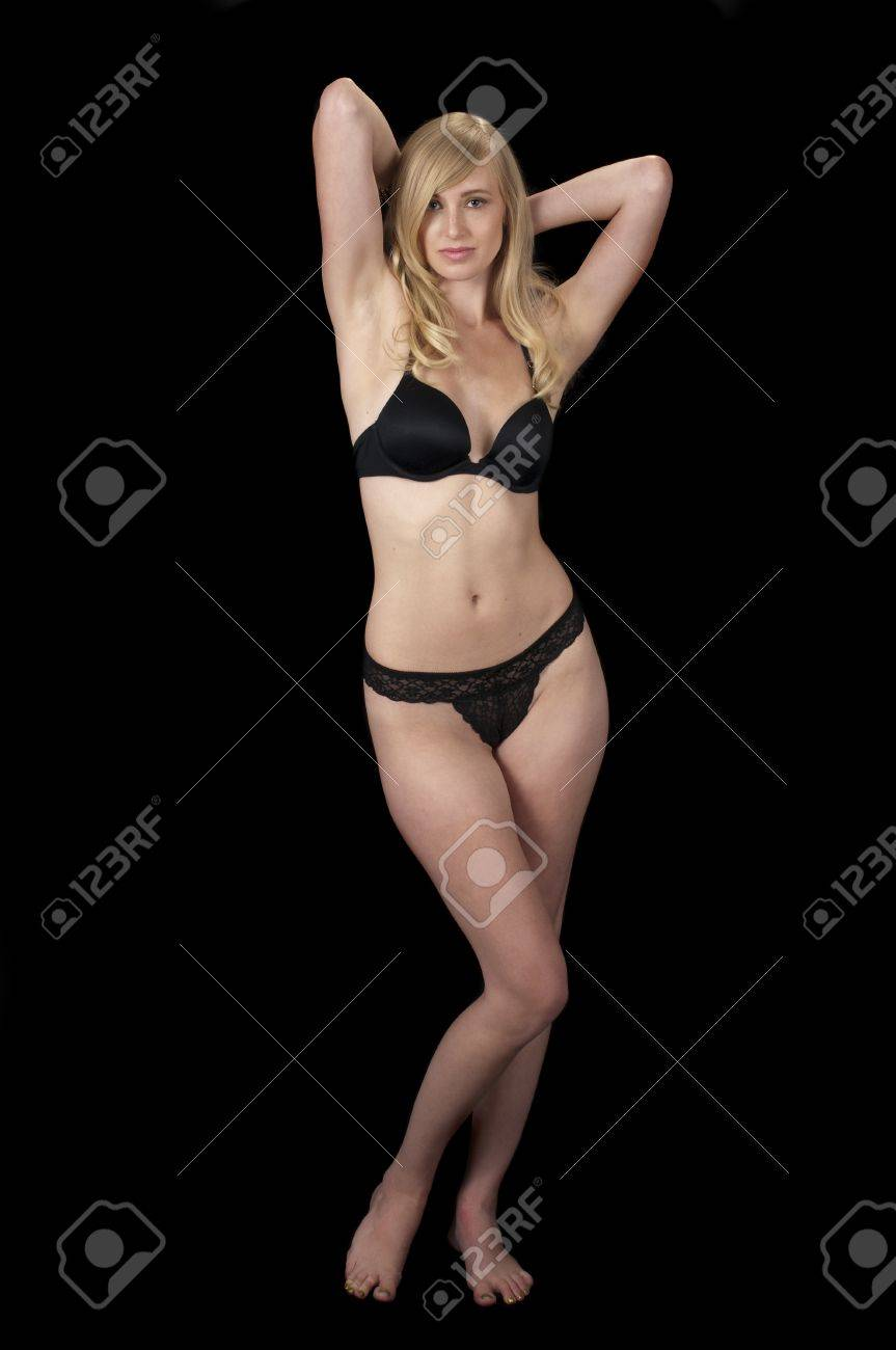 The Evening Wear Striptease Sequence: High fashion model in black lingerie unfastening her bra. Stock Photo - 9800866