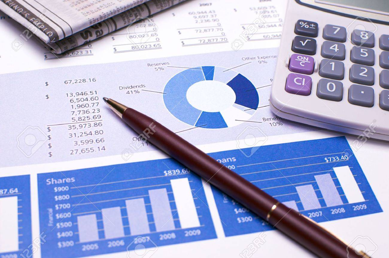 financial planning and review of year end reports stock photo financial planning and review of year end reports stock photo 5748828