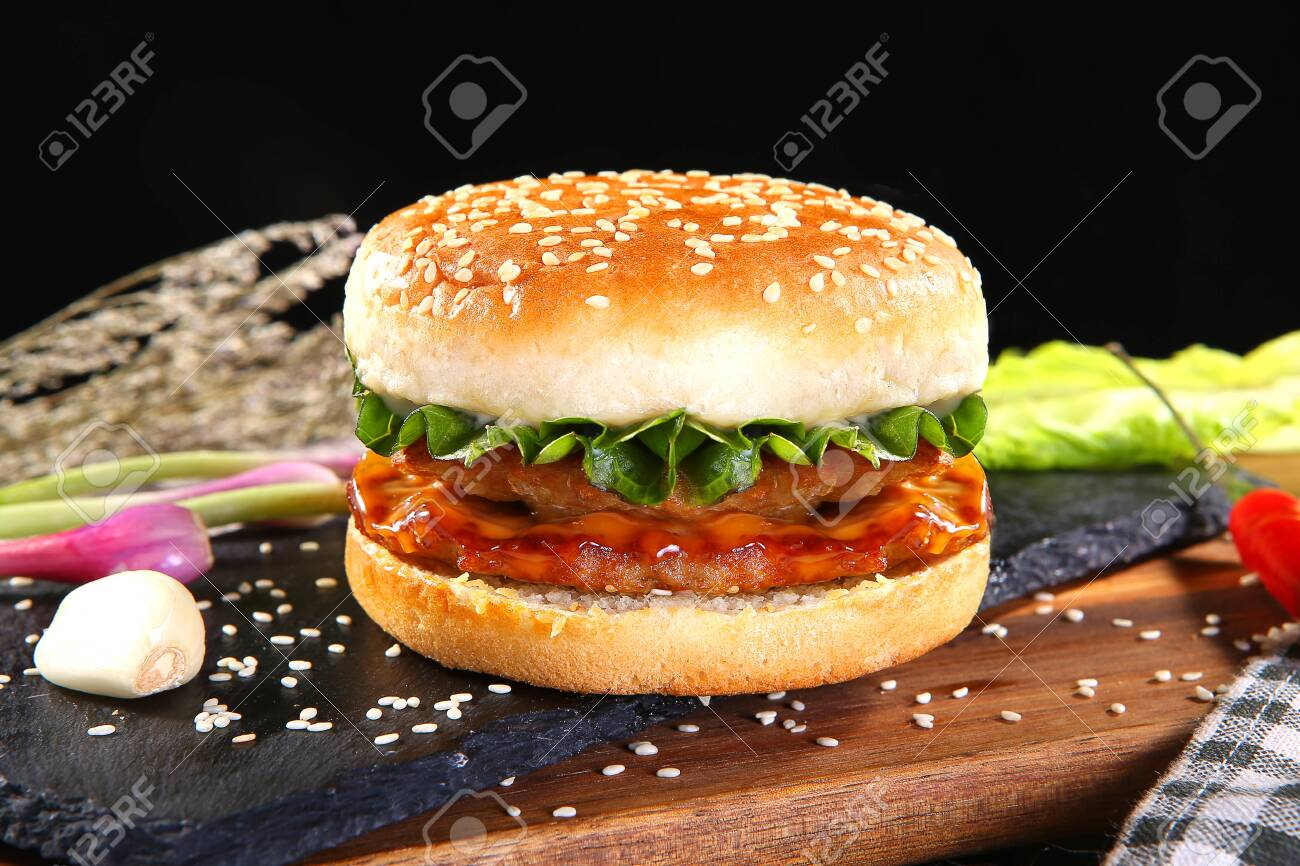 Double beef burger on a black stone slab - 121824087