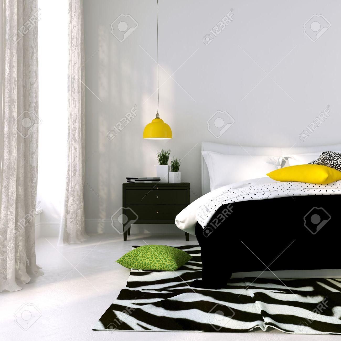 Slaapkamer in zwart wit met de gele lamp en gekleurde kussens ...