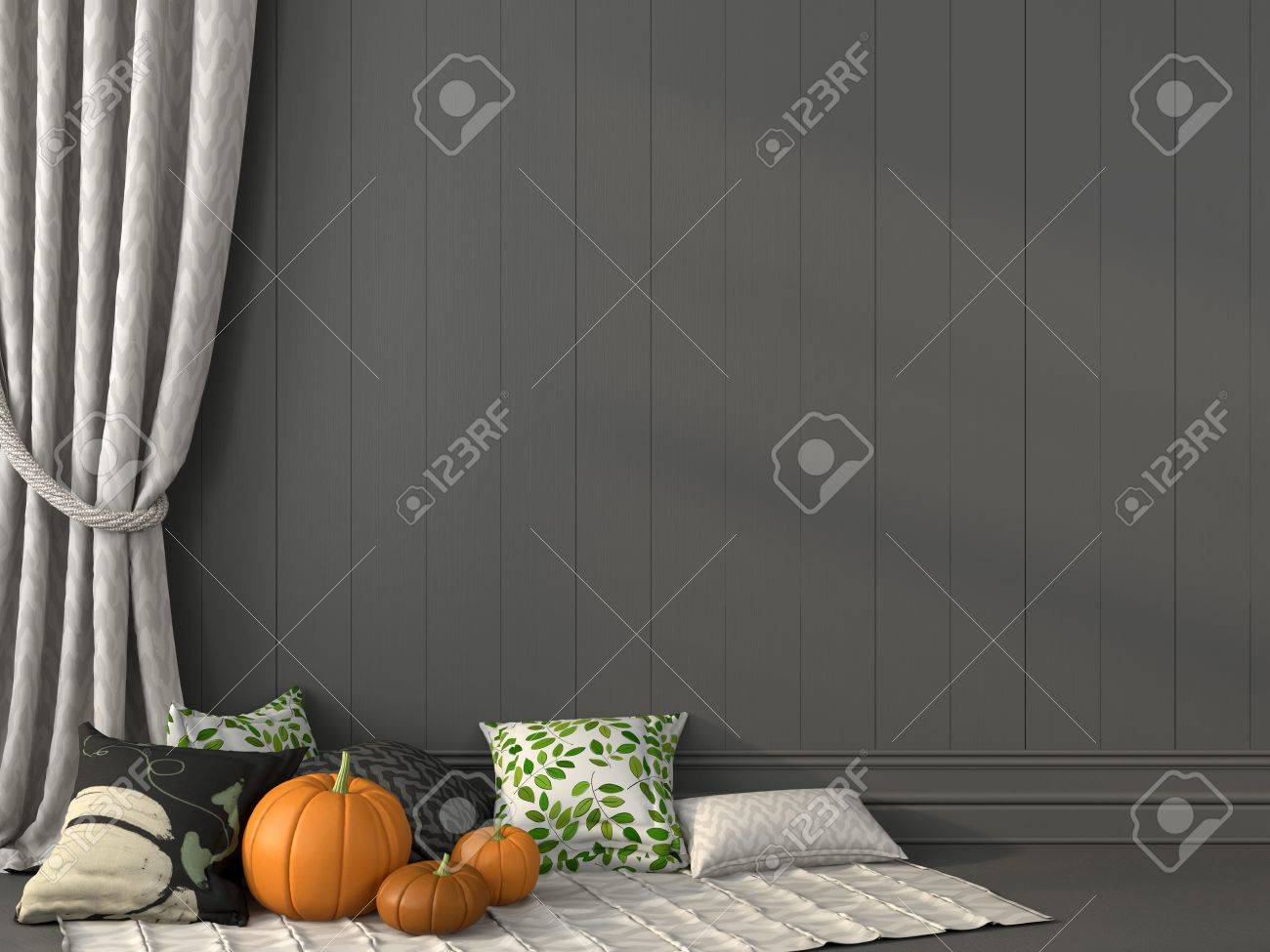 pillows with print topical for halloween against the backdrop of gray wall and curtain stock photo