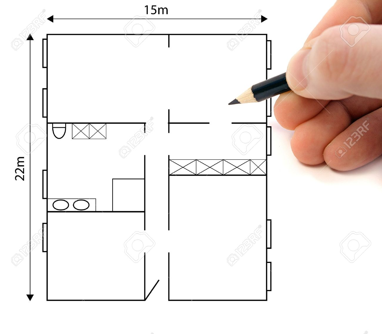 A hand drawing a ground plan to plan a building project stock photo 6186742