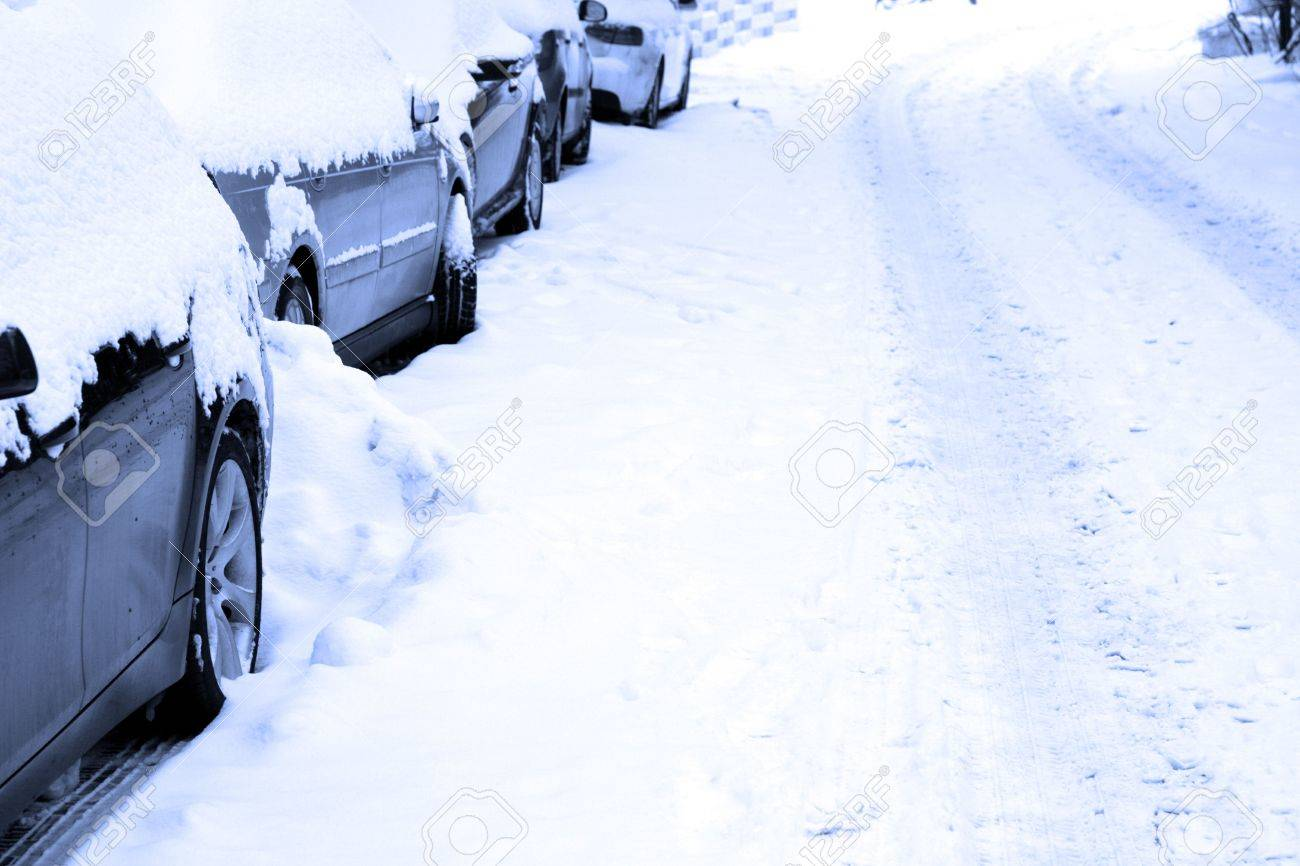 Several cars parking on a snowbound street. Stock Photo - 6293707