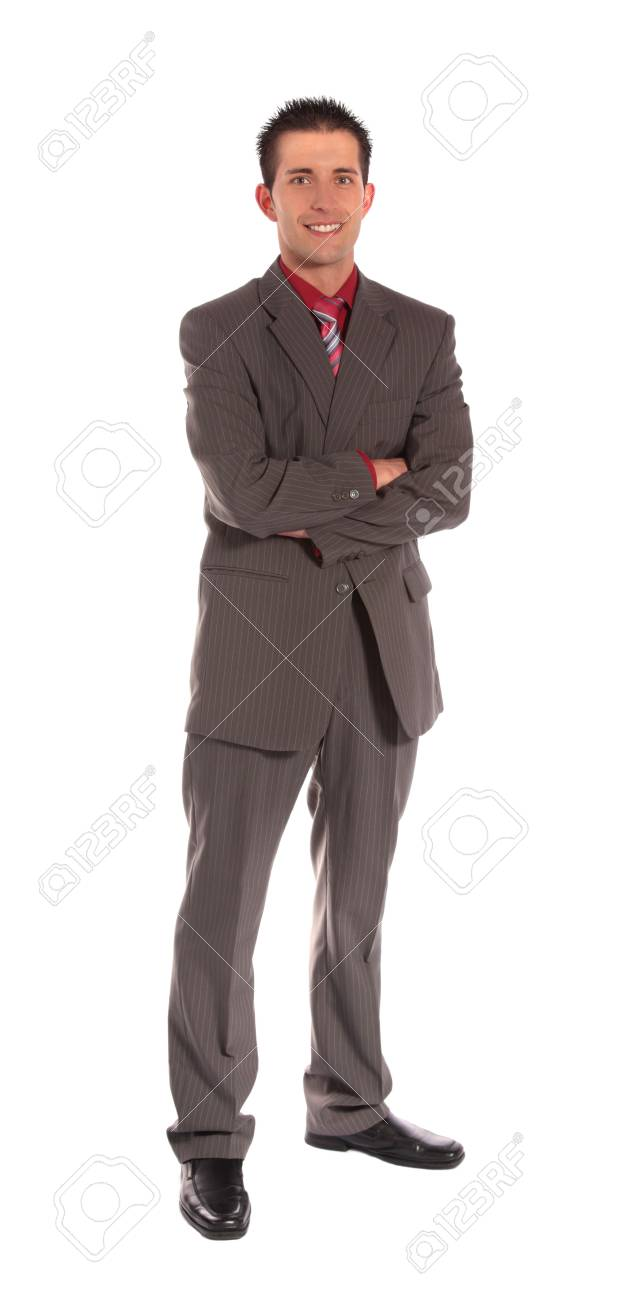 A handsome businessman standing in front of a plain white background. Stock Photo - 6813421