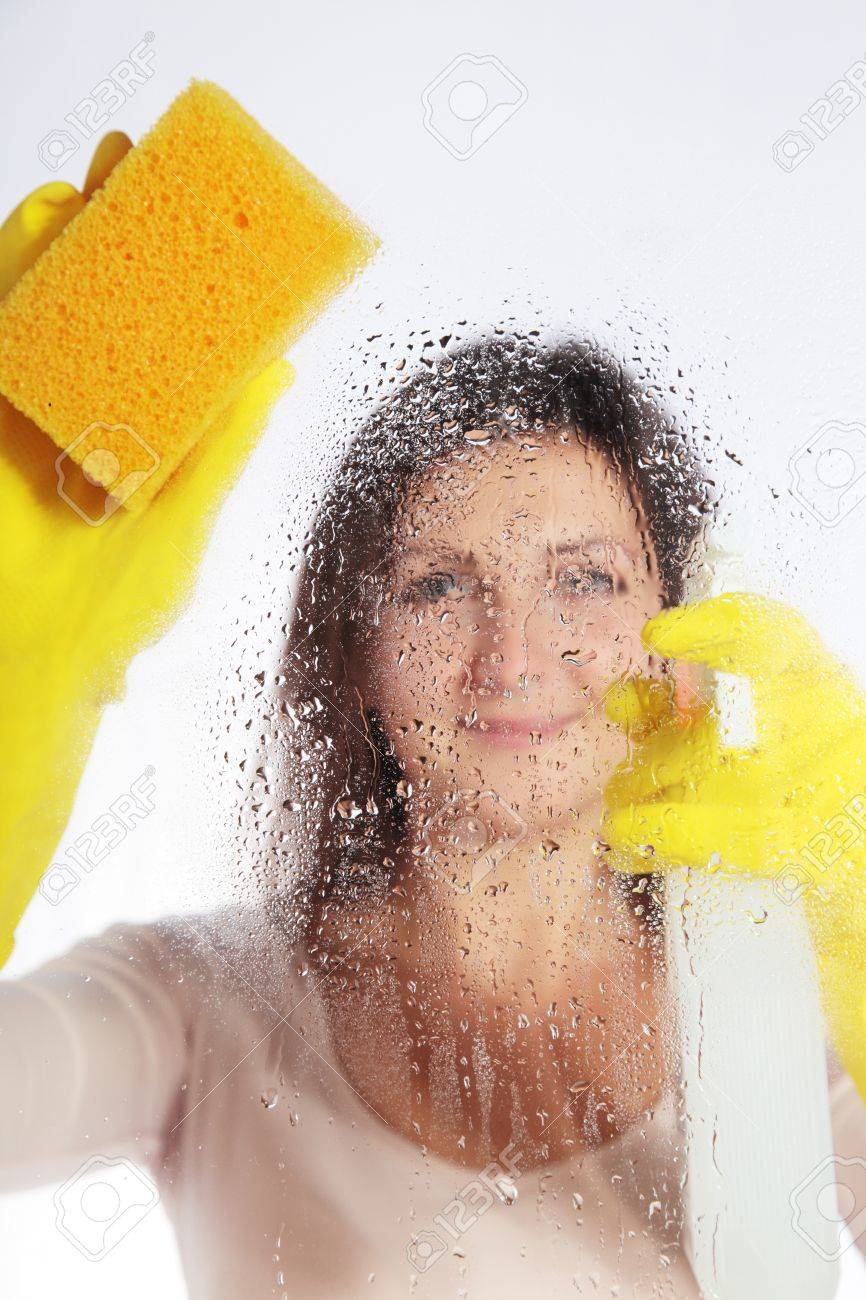 Attractive young woman cleaning windows Stock Photo - 7864921