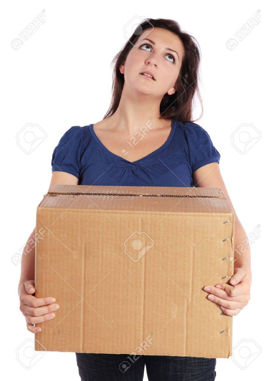 Exhausted young woman carrying a moving box Stock Photo - 7864923