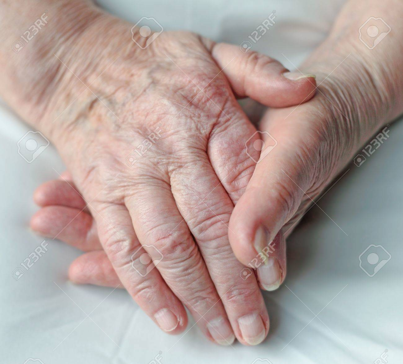 Old wrinkled hands of an elderly person. Stock Photo - 8433590