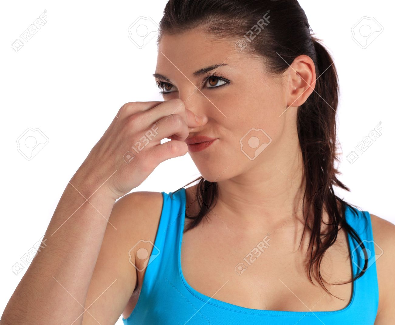Attractive young woman smells something ugly. All on white background. Stock Photo - 8510483