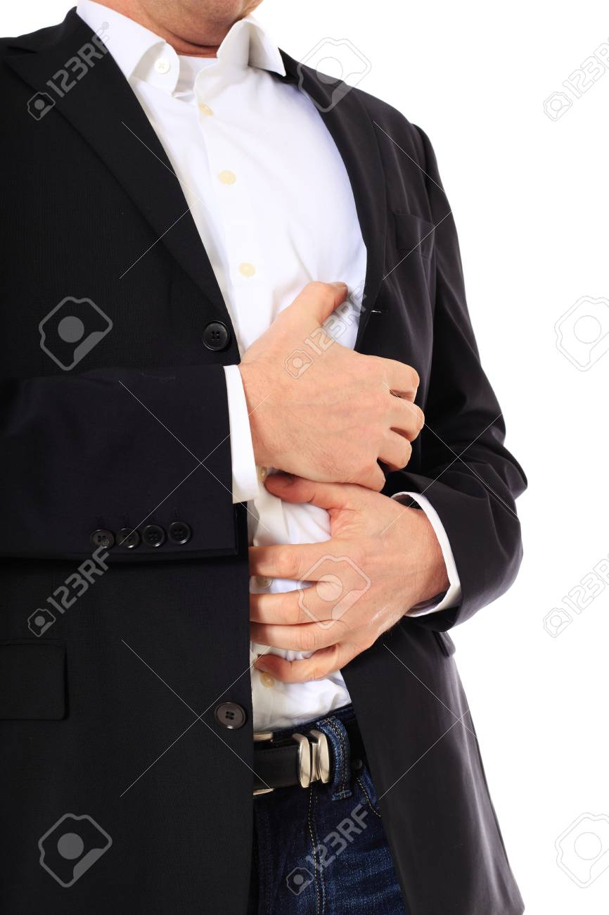 Attractive middle-aged man suffering from stomachache. All on white background. Stock Photo - 8824941