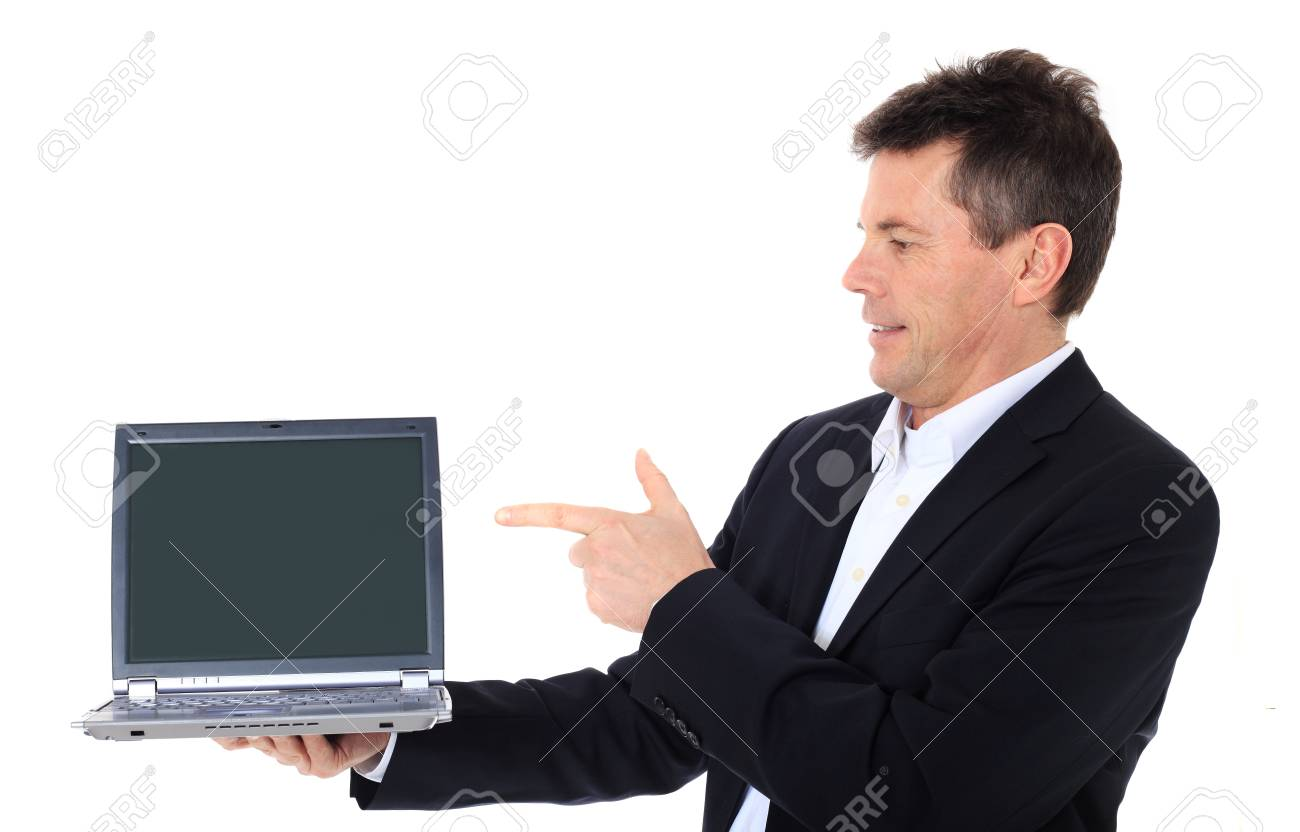 Attractive middle-aged man pointing on notebook computer. All on white background. Stock Photo - 8824857