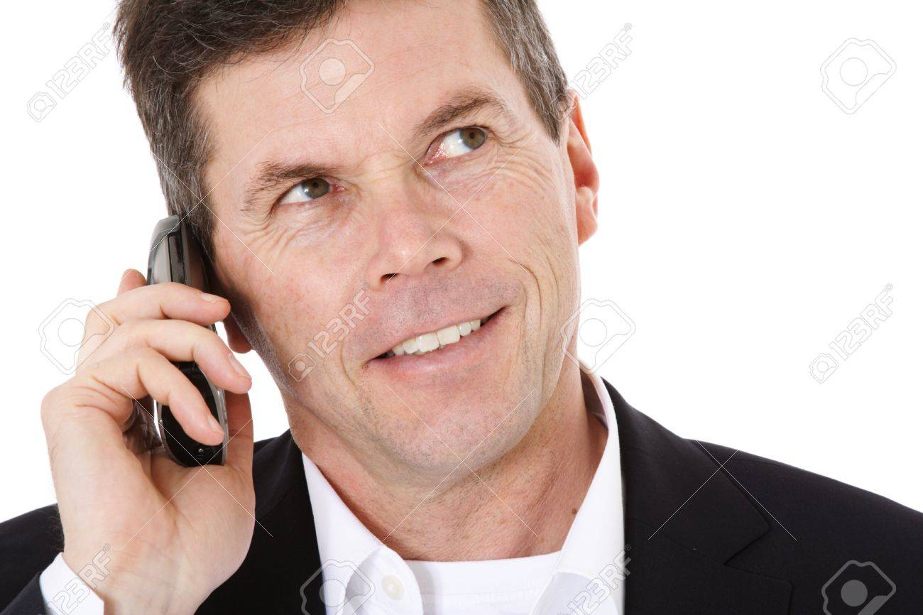 Attractive middle-aged man making a phone call. All on white background. Stock Photo - 8824827