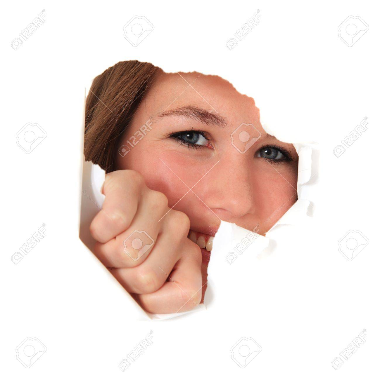 Female person looking through torn hole in white wall. All on white background. Stock Photo - 10118498