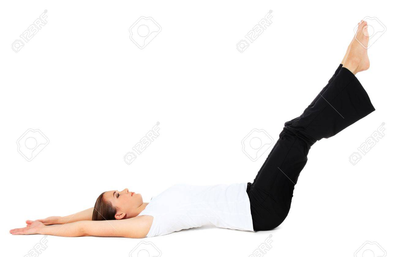 Attractive young woman in sports wear doing gymnastics. All on white background. Stock Photo - 10334406