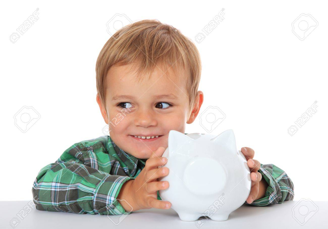 Cute caucasian boy with his piggy bank. All on white background. - 10865575