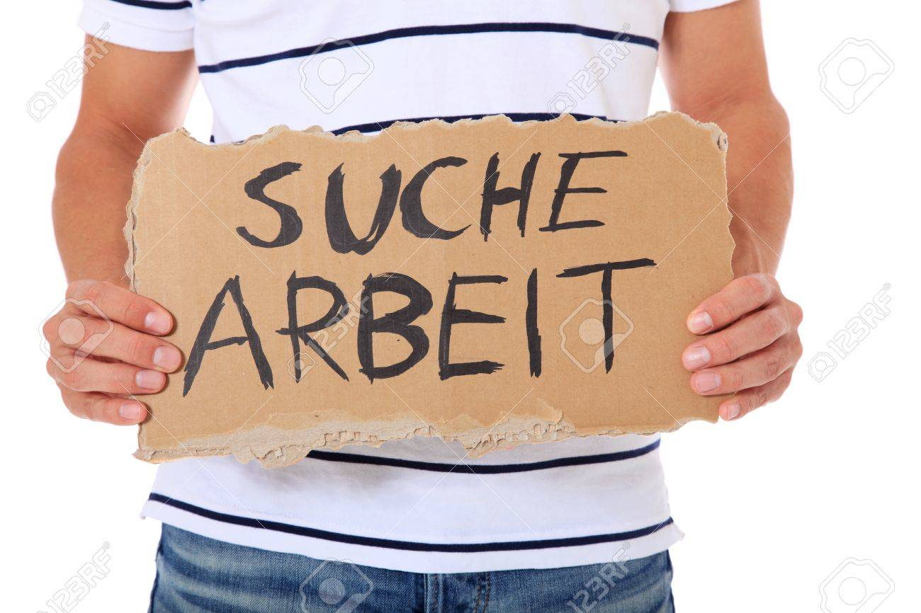 male person holding cardboard sign the german term suche male person holding cardboard sign the german term