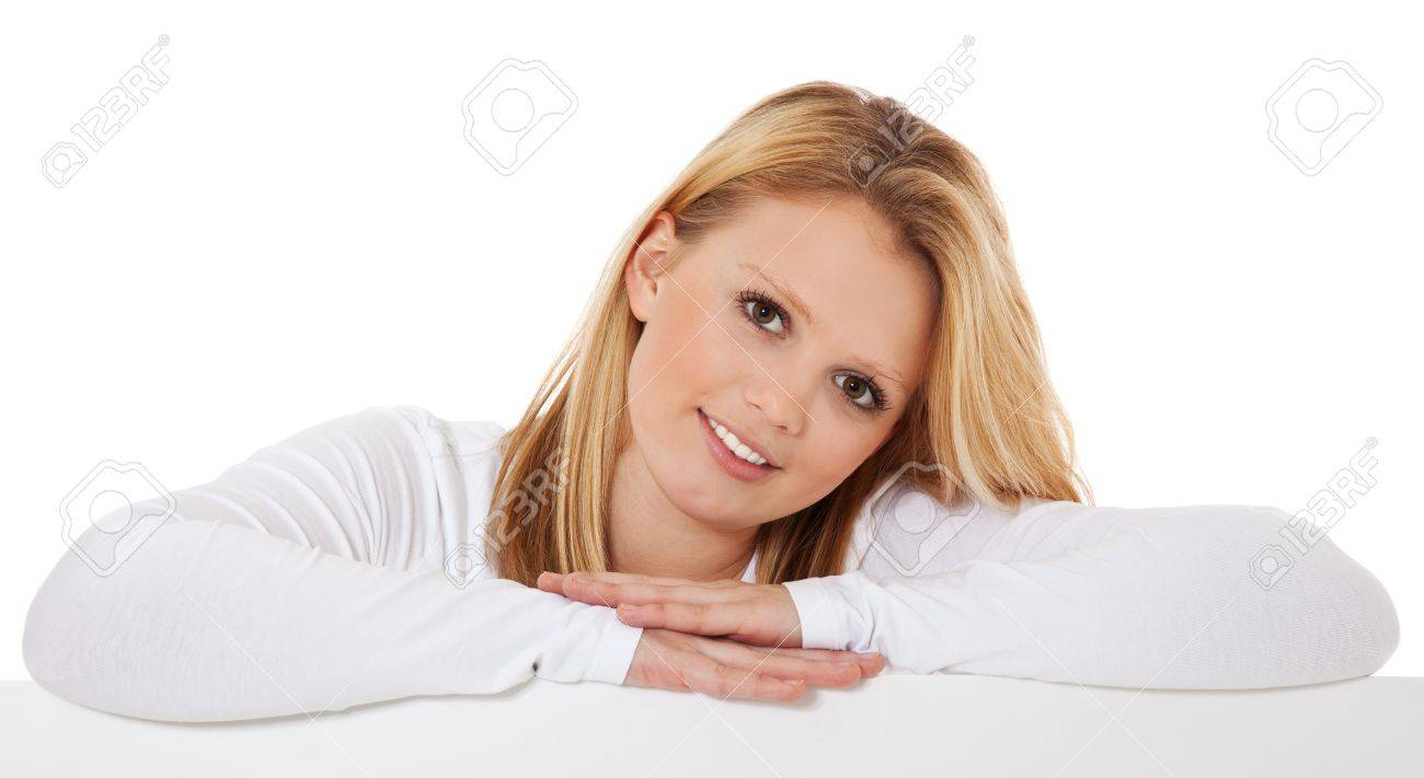 Attractive teenage girl behind white wall  All on white background Stock Photo - 12860006