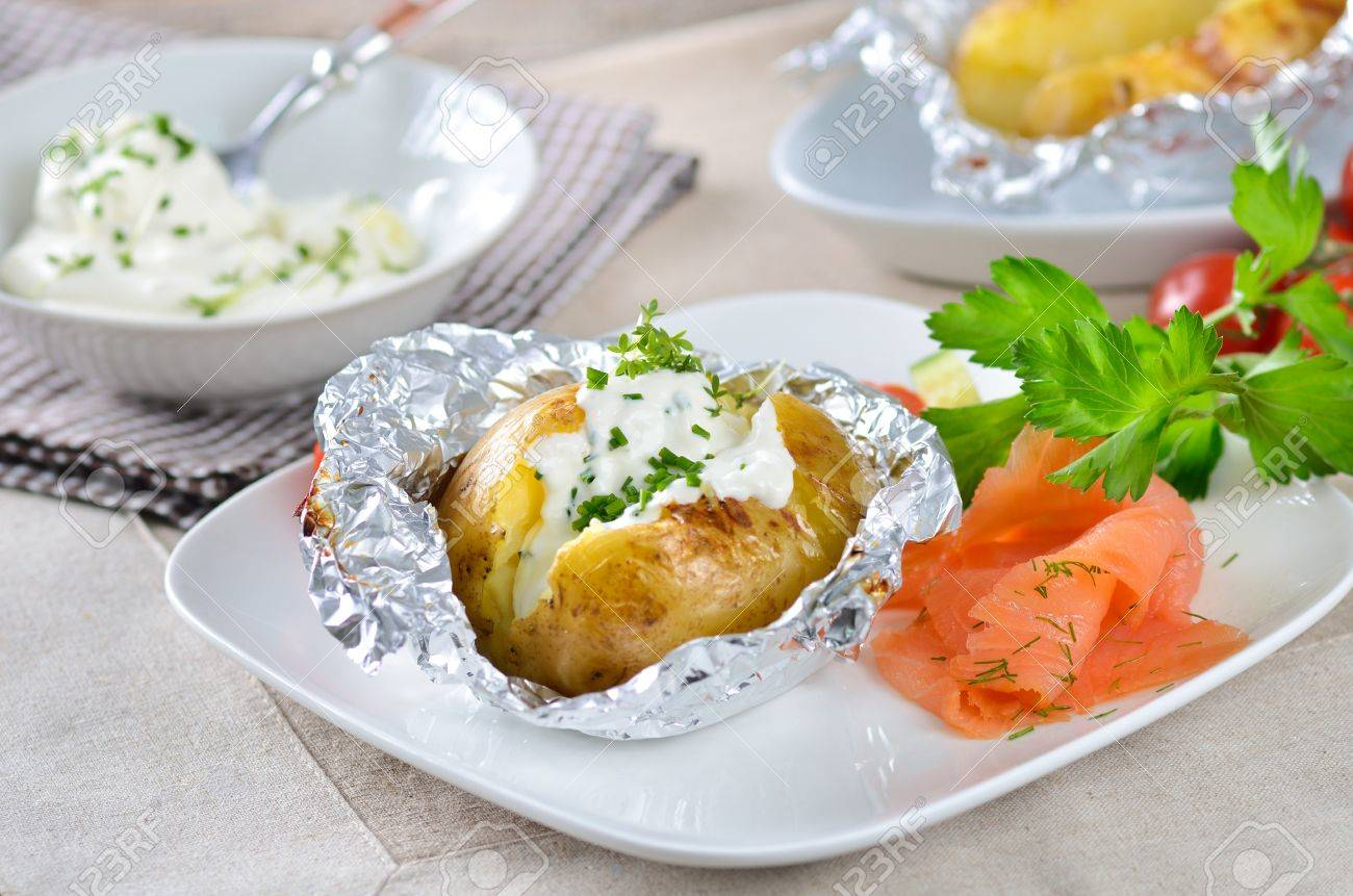 Jacket potato with sour cream and smoked salmon Stock Photo - 11782998
