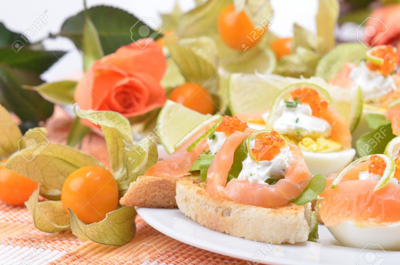 Canapes with salmon and caviar Stock Photo - 13090494