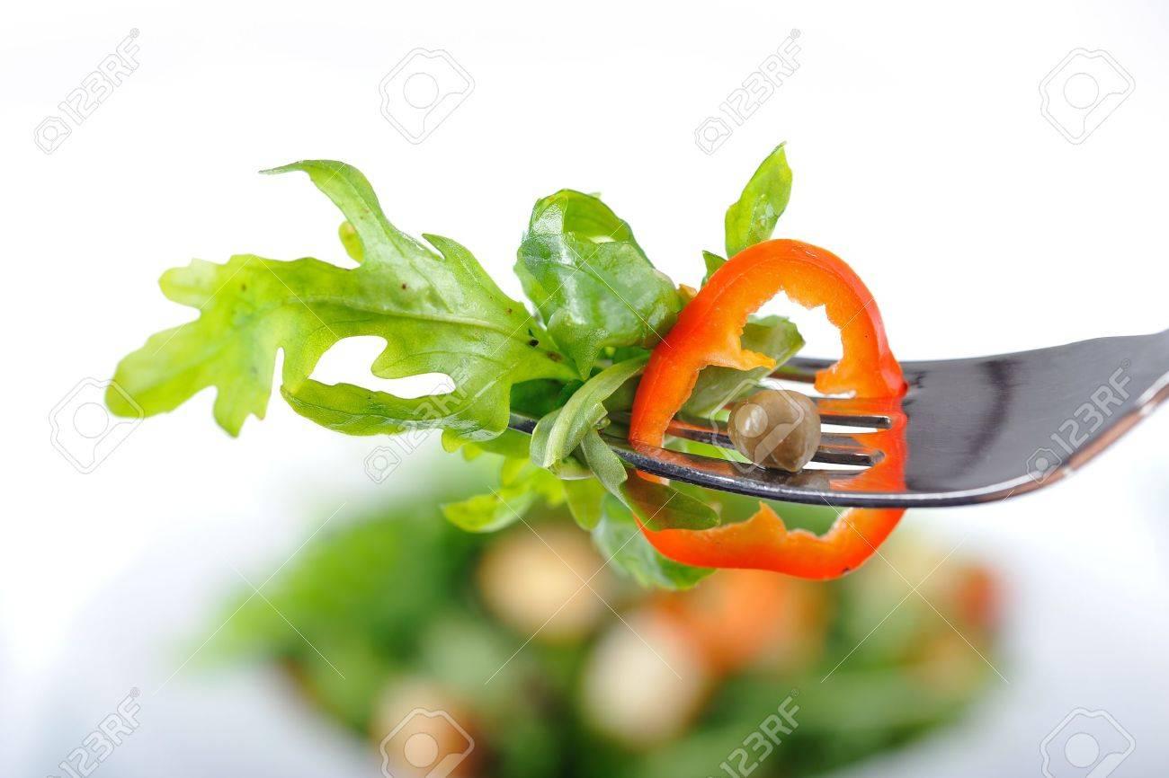 Fresh rucola salad on a fork Stock Photo - 13285616