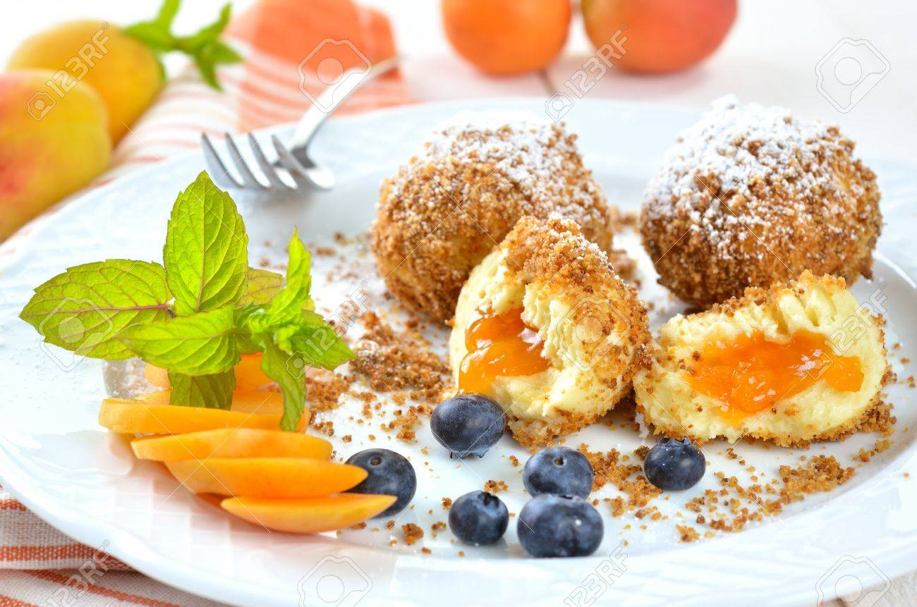 Sweet apricot dumplings with some blueberries Stock Photo - 20919099