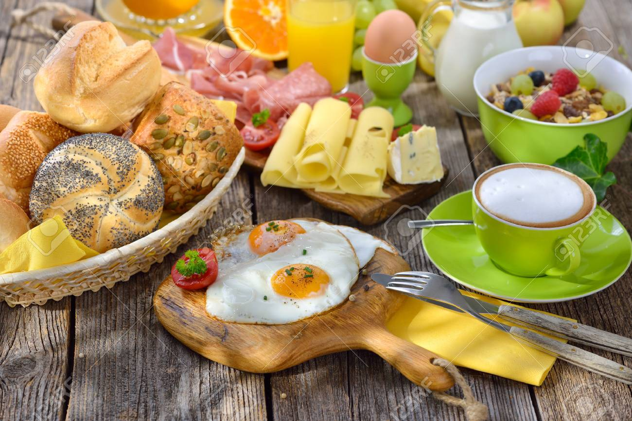 Outside served luxuriant breakfast with fried eggs a wide selection of other foods - 61877631
