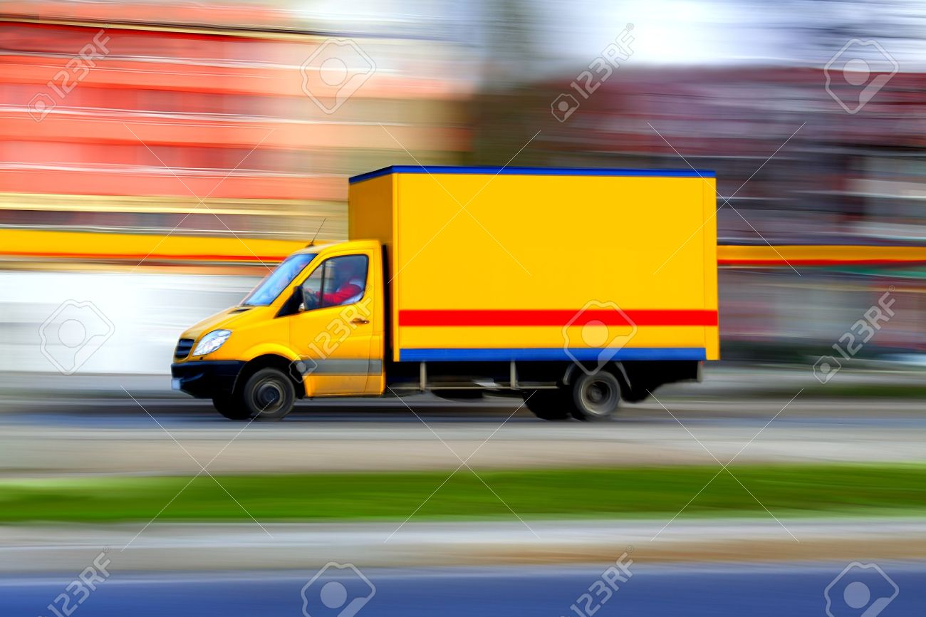 Speedy yellow van always is  on time, panning and blur Stock Photo - 10318586