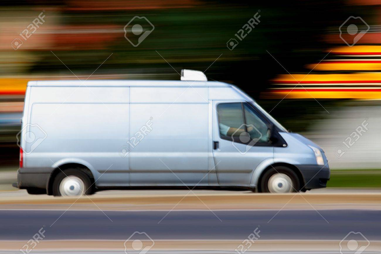 Speedy blue van always is  on time, panning and blur Stock Photo - 10327612