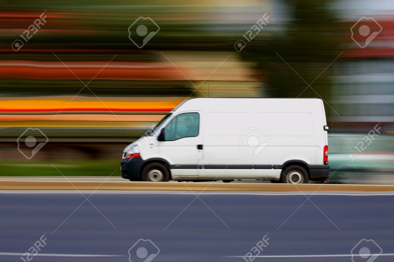 Blur speedy  white van with white blank for your text Stock Photo - 10327623