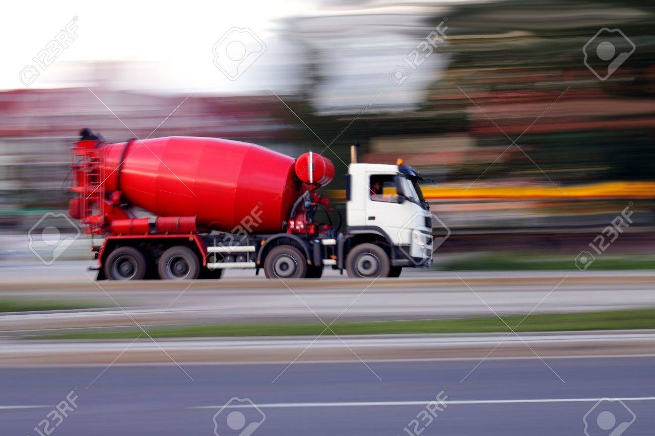 Blur red concrete mixer is going to build soon Stock Photo - 10327639