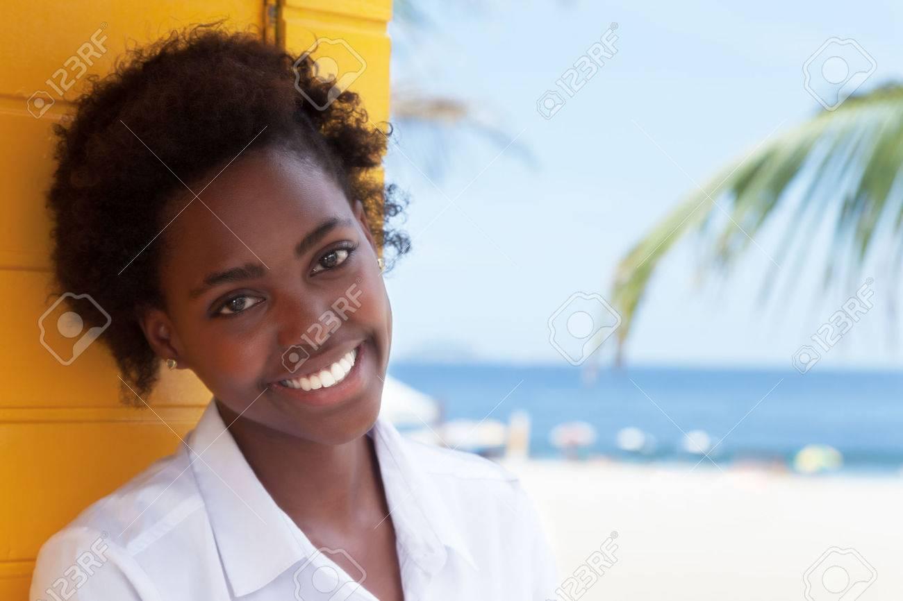 Happy african american girl near beach - 46781040
