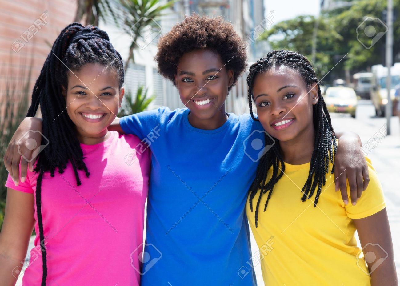 Three beautiful african american girlfriends in the city - 52087202