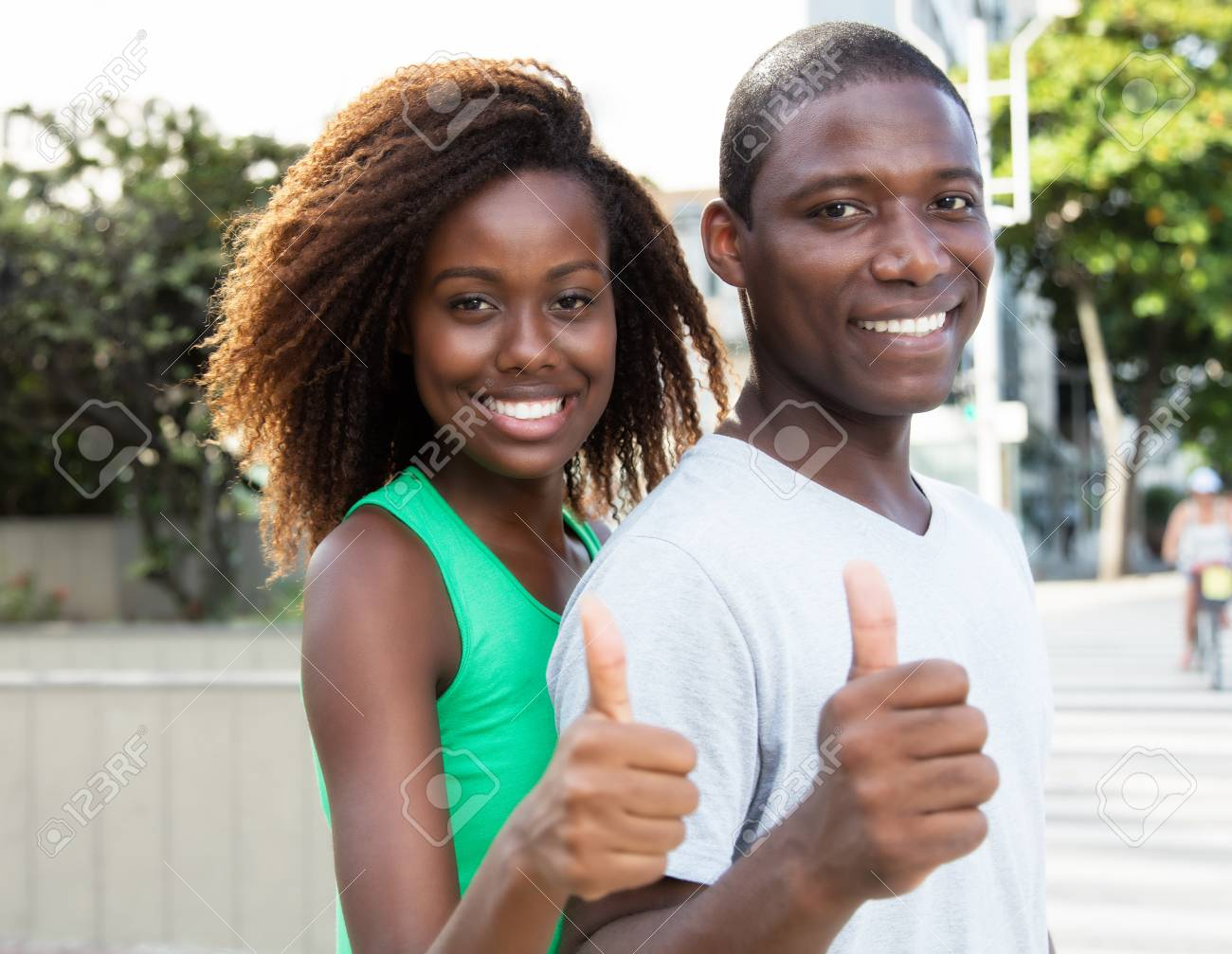 Beautiful african american couple showing thumb in the city - 60541006
