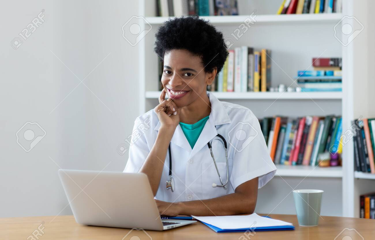 African american mature female doctor working at office - 127363744