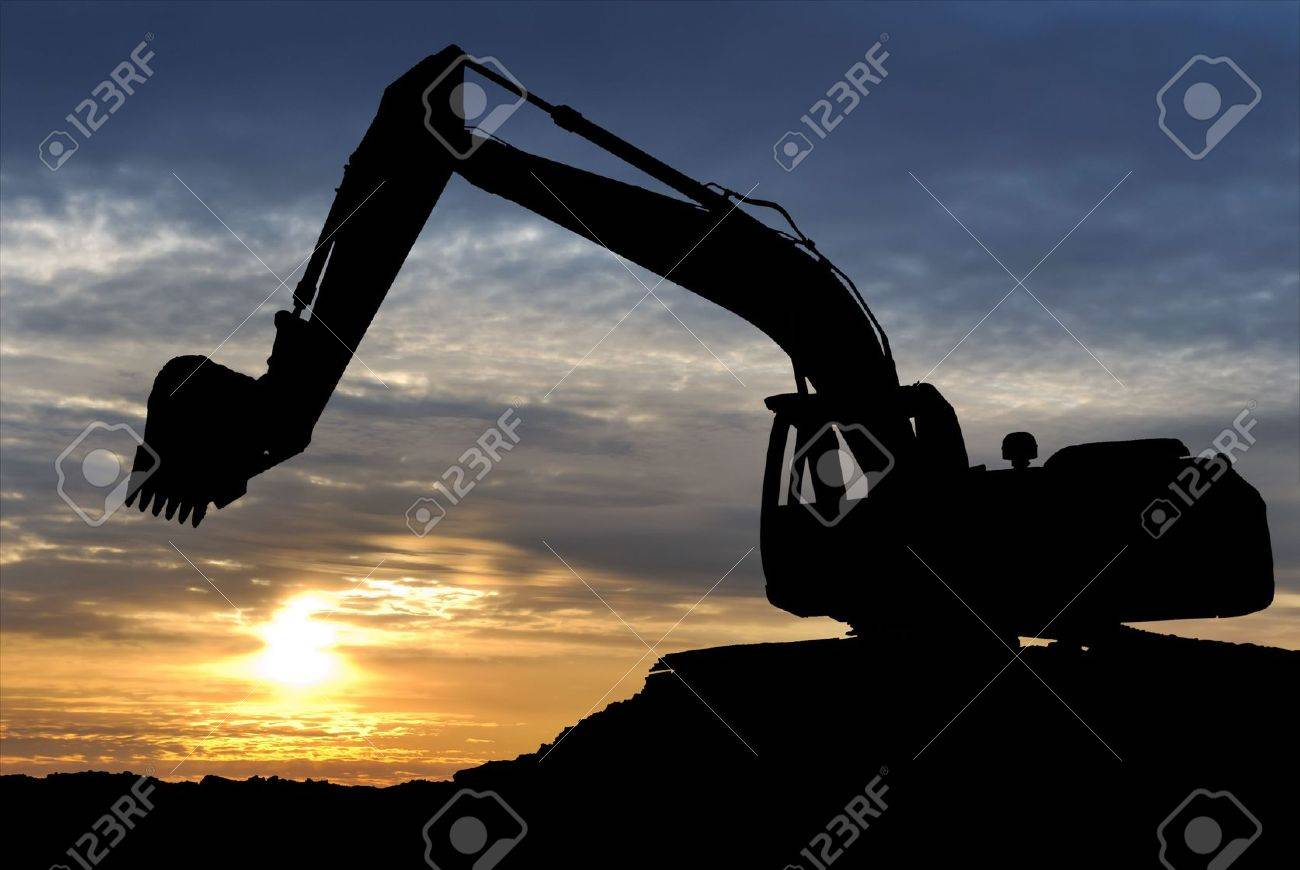 silhouette of Excavator loader at construction site with raised bucket over sunset Stock Photo - 6177028