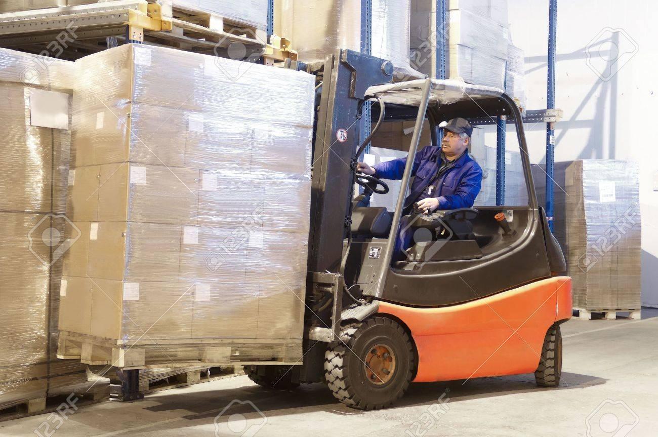 Forklift loader worker driver at warehouse Stock Photo - 7156211