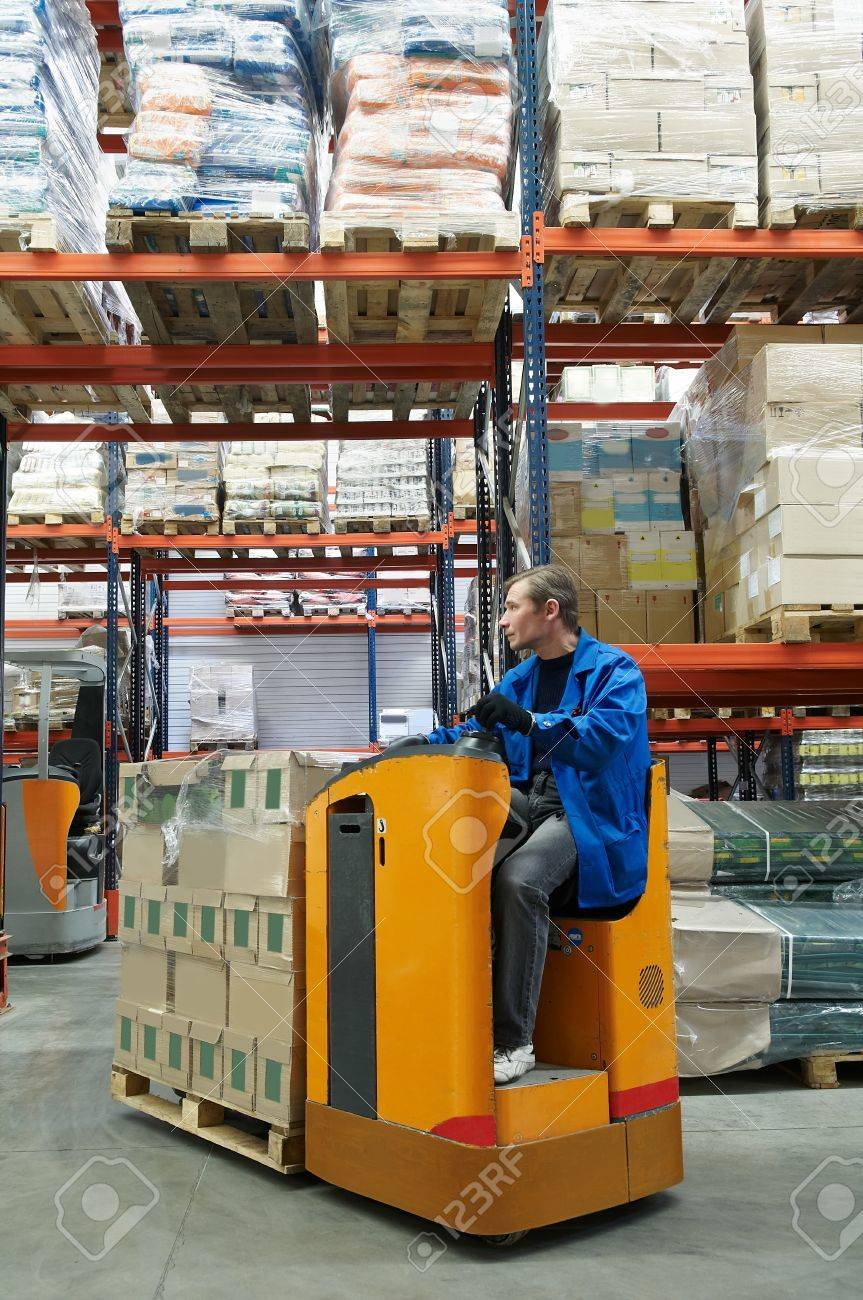 low level picker loader with driver in a warehouse Stock Photo - 7398169