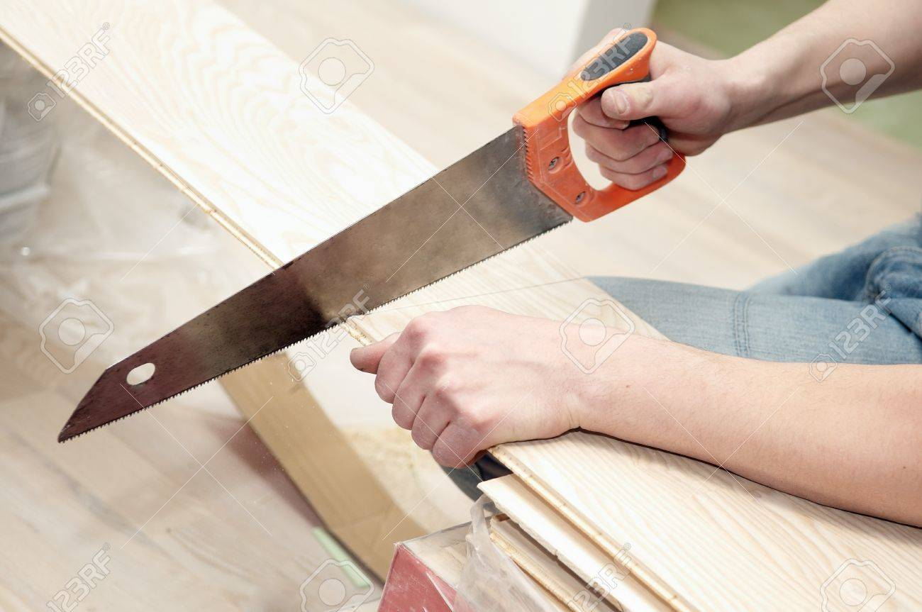Closeup Work Operation Of Cutting Wood Furniture By Hand Saw Stock