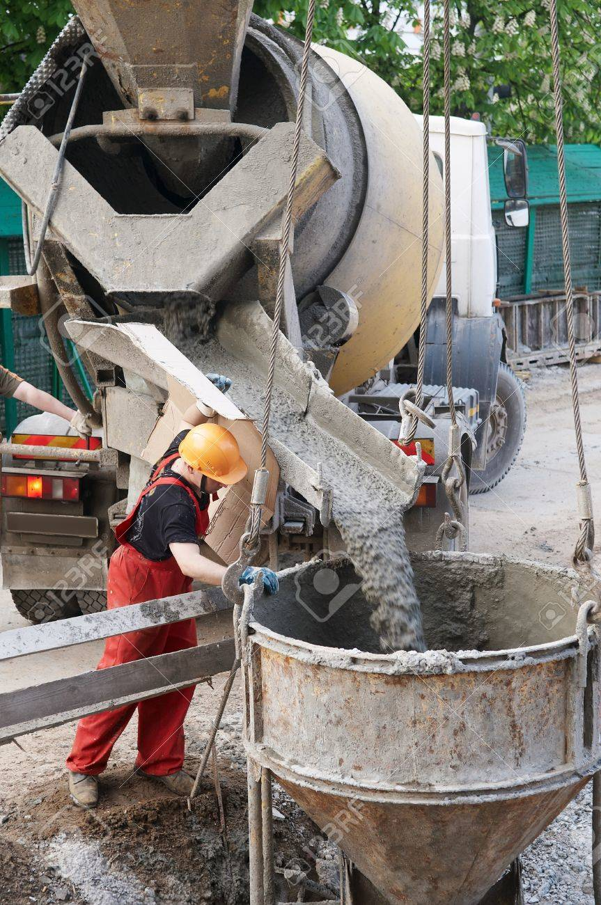 worker builder controlling concrete filling process at construction