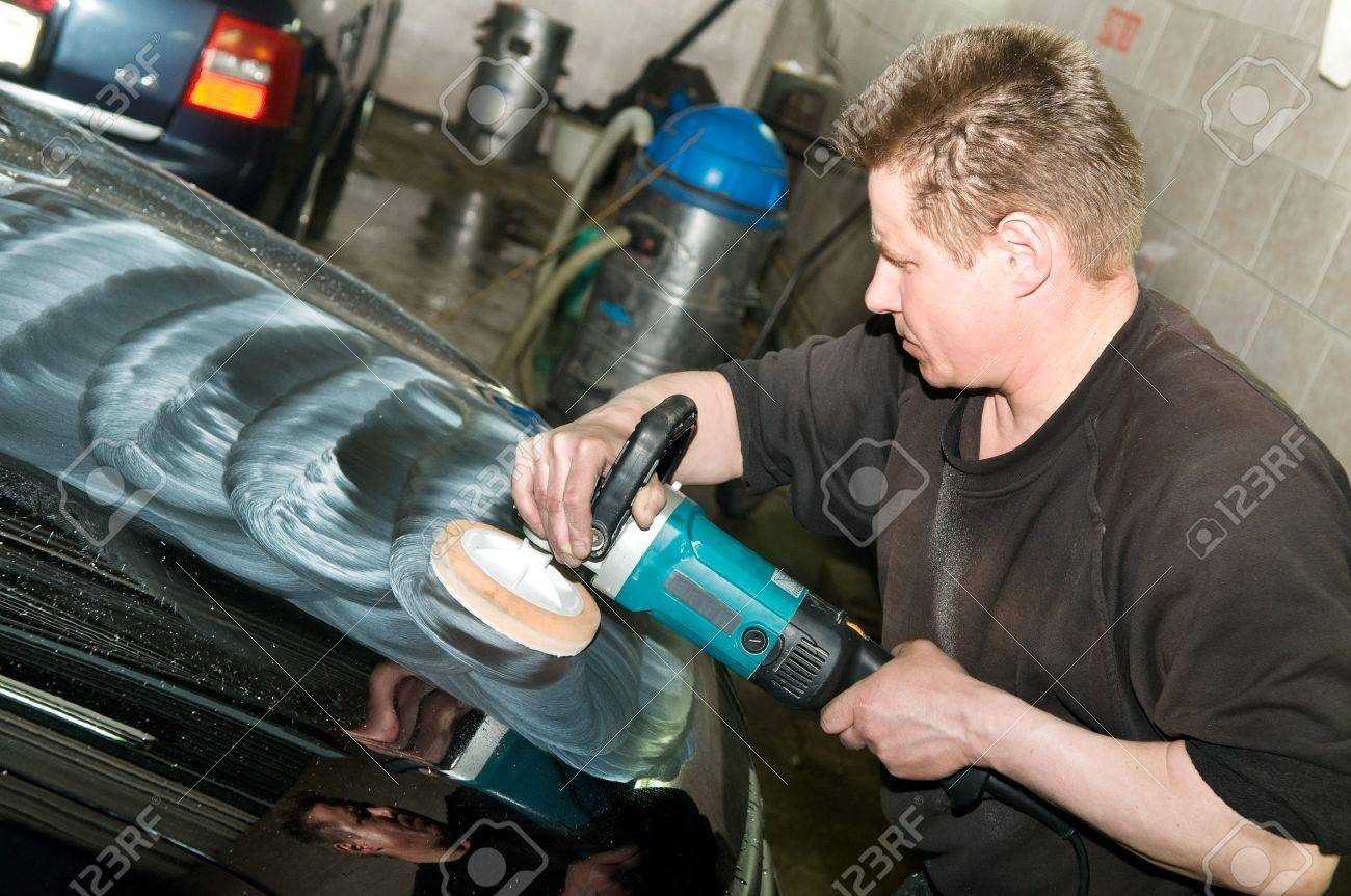 car care work with machine polisher at service station Stock Photo - 7397888