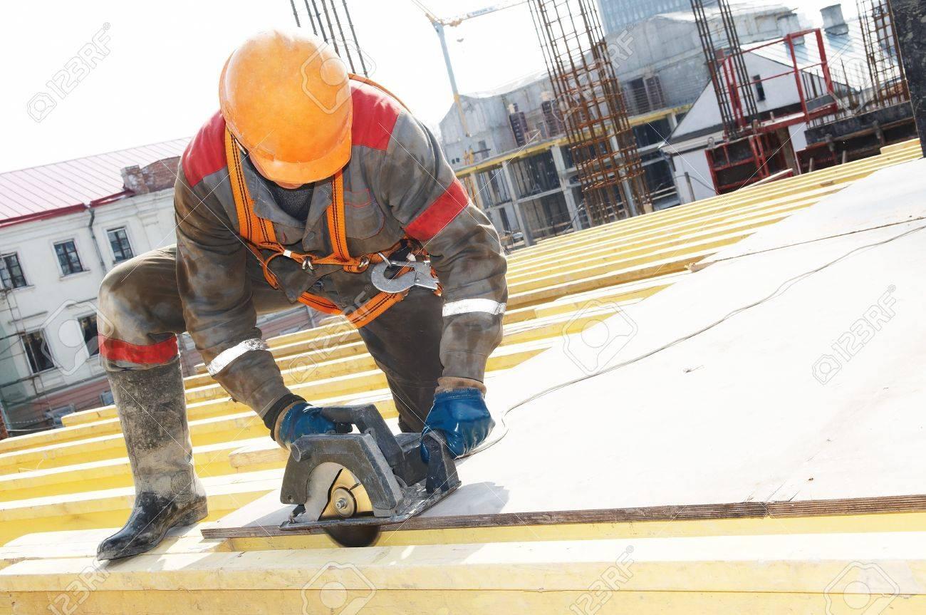 builder working in protective wear, helmet and equipment Stock Photo - 7397880