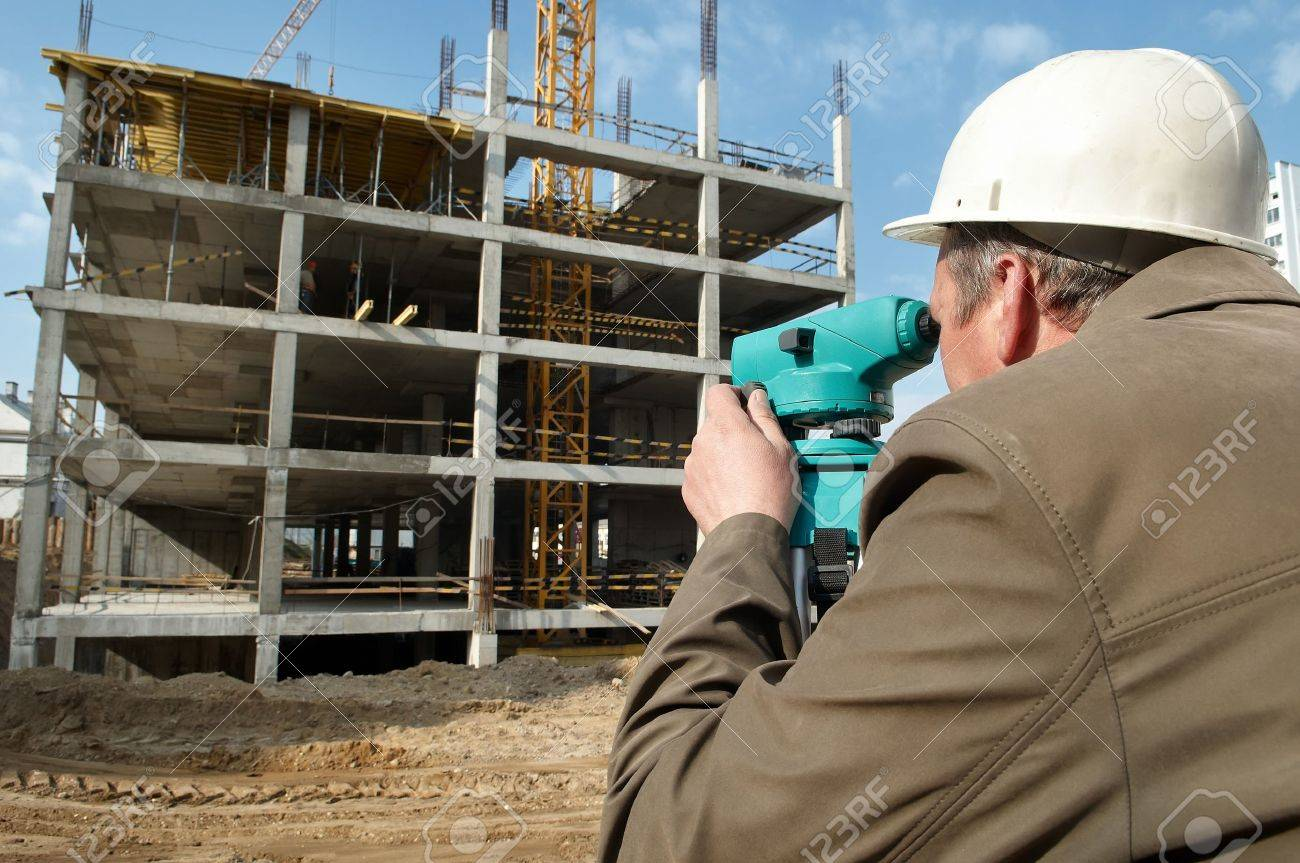 worker surveyor measuring distances, elevations and directions on construction site by theodolite level transit equipment Stock Photo - 7397823