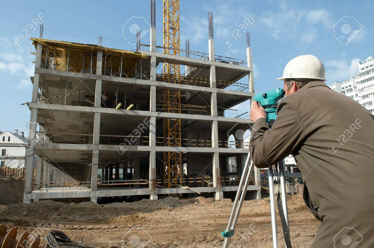 worker surveyor measuring distances, elevations and directions on construction site by theodolite level transit equipment Stock Photo - 7398154