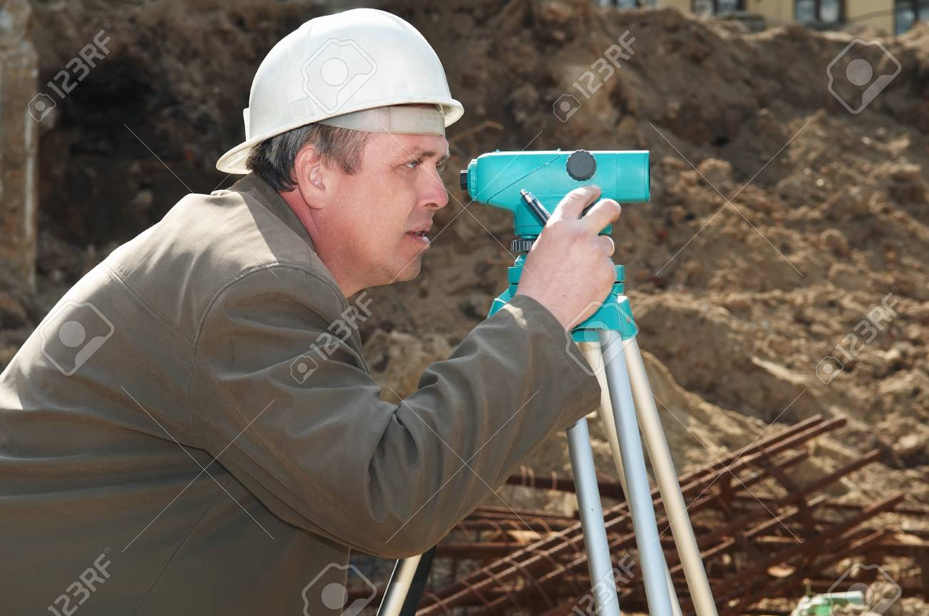 worker surveyor measuring distances, elevations and directions on construction site by theodolite level transit equipment Stock Photo - 7421544