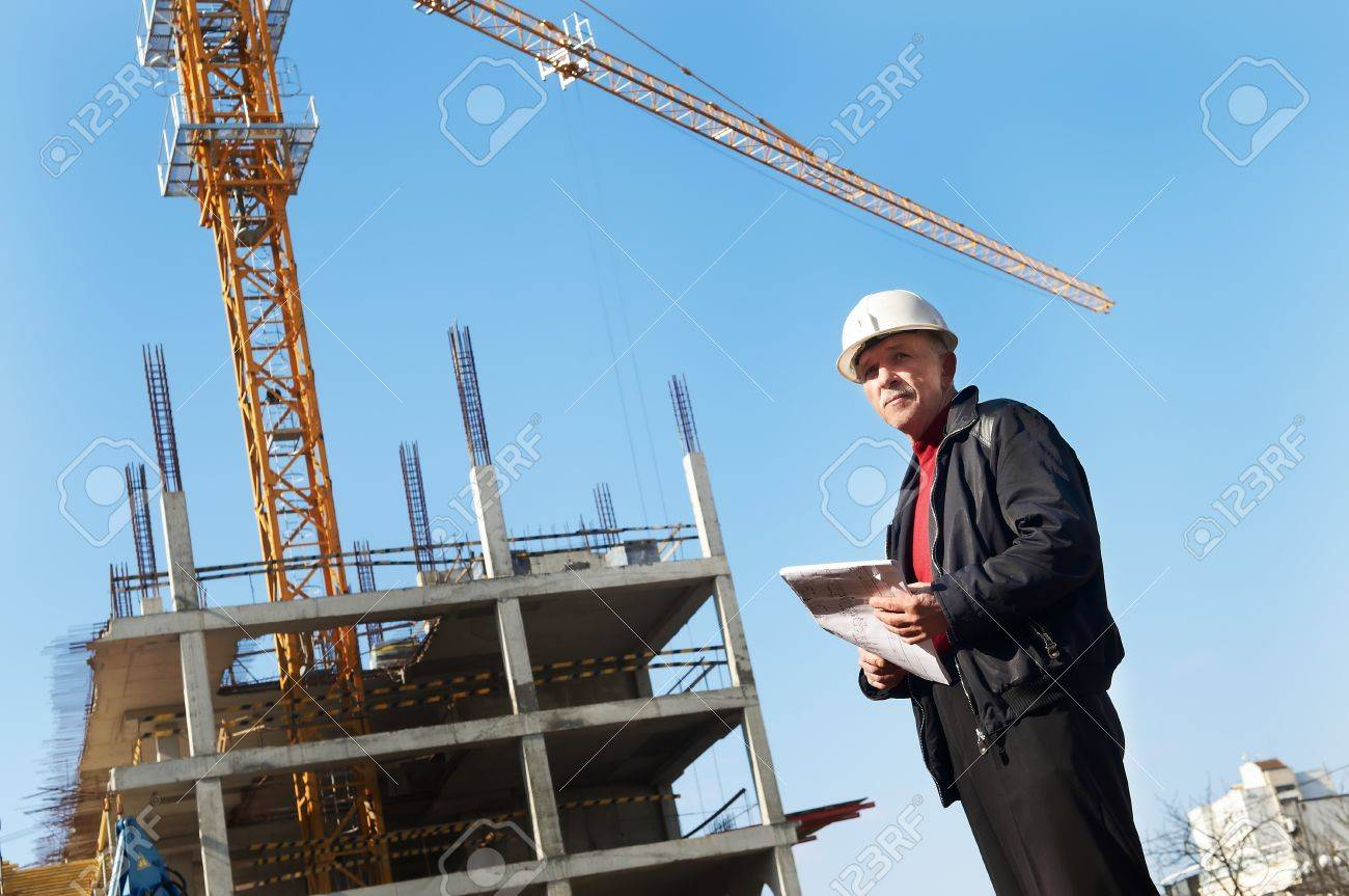 positive builder inspector worker at construction site Stock Photo - 7682615
