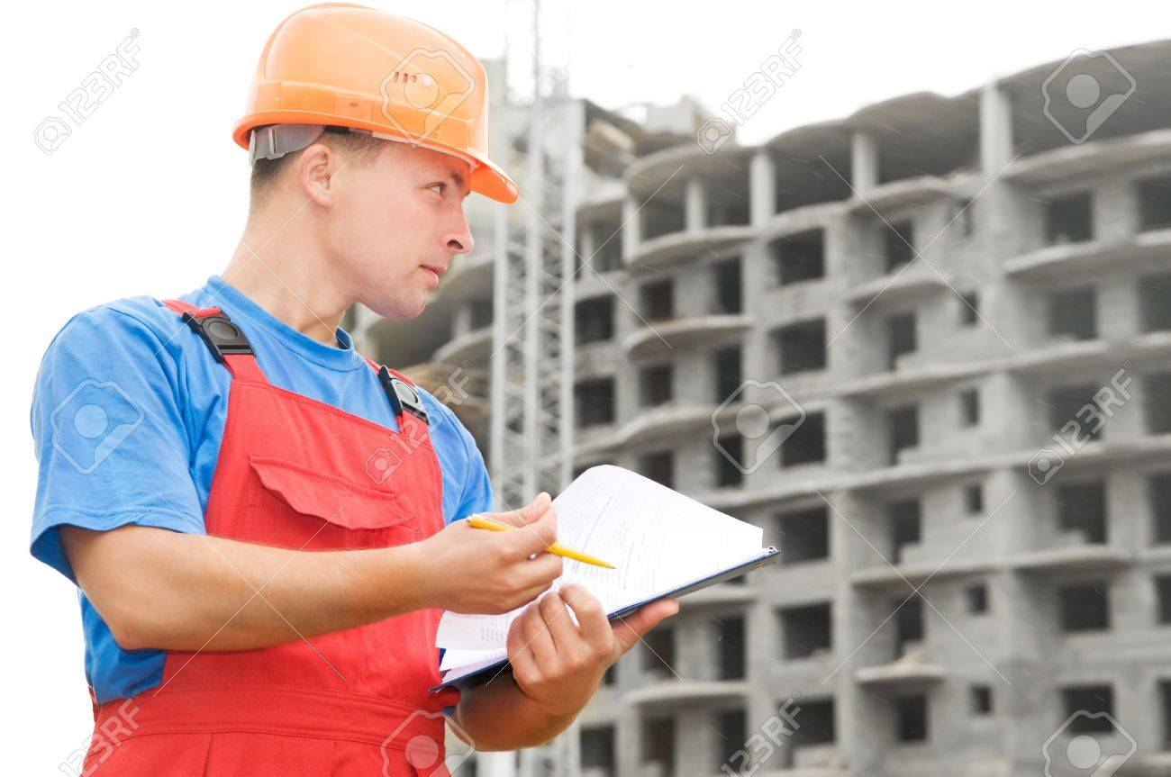 One builder worker with clipboard inspecting works at construction site Stock Photo - 7682594